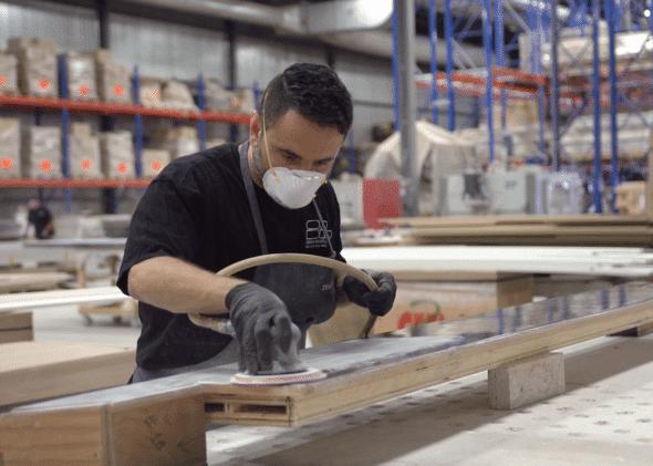 Man sanding architectural millwork